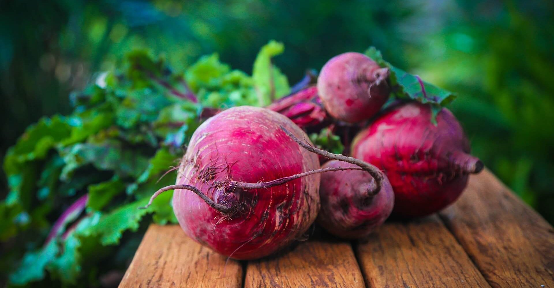 Fresh beets on wood bench